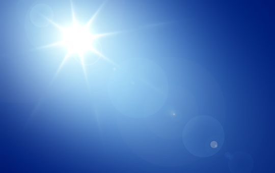 Blue Sky Sun Flare Background